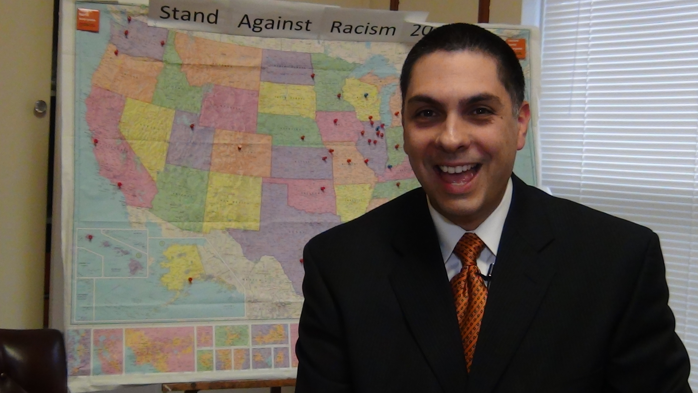 Jose Hernandez of the YWCA of Greater Trenton prepares to tape a promotional message about the Stand Against Racism program