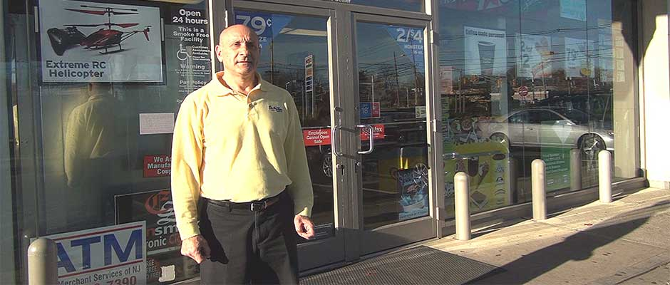 Samir Yazigi, owner of On the Run, Green Brook, NJ, stands outside his gas station convenience store, in a Unity Bank video produced by the Lubetkin Media Companies.