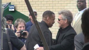 Rocker Jon Bon Jovi, right, is greeted at the Joseph's Homeless Shelter ribbon cutting April 1 in Camden.