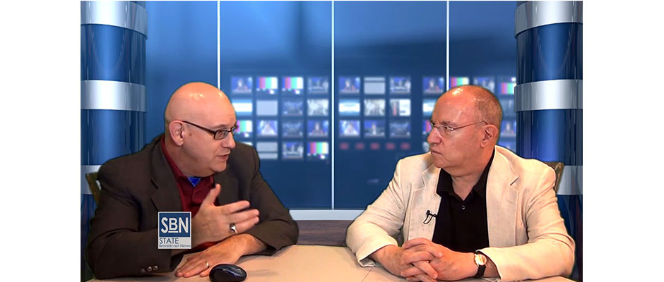 Peter Key, right, discusses the comic strip cartoons of his father, Peter Key, with Steve Lubetkin in the StateBroadcastNews.com studios.